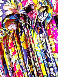 Hawaiian shirts available for purchase at the marketplace.