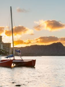 Diamond Head at sunset is visible at Waikiki